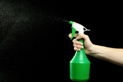 Hand and spray bottle for cleaning up Royalty Free Stock Image