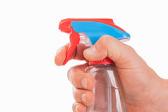 A hand with spray bottle Royalty Free Stock Photos