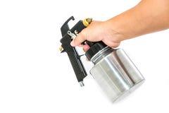 Hand and spray gun Royalty Free Stock Photo