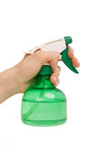 Hand with spray for spraying Stock Photos