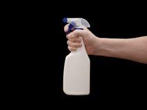 Hand & Sprayer. An isolated over black caucasian man's hand holding a blank spray bottle stock photos