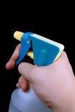 Hand with sprayer. Hand pressing the trigger of household sprayer Royalty Free Stock Photo