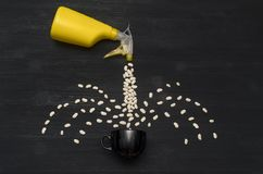 Hand sprayer and kidney beans and black tea cup. royalty free stock image