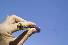 Hand with a spyglass Stock Images