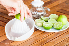 Hand squashing fresh lime Royalty Free Stock Photo