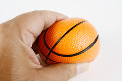 Hand squeeze antistress small  basket ball. On white Stock Photography