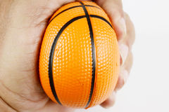 Hand squeeze antistress small  basket ball. On white Royalty Free Stock Image