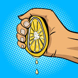 Hand squeeze lemon pop art comic book style vector Royalty Free Stock Images