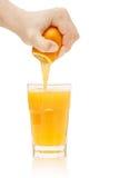 Hand squeezes juice Stock Photo