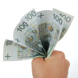 Hand squeezing bunch of banknotes Stock Photo