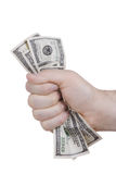 Hand squeezing bunch of dollar. S against white background Royalty Free Stock Image