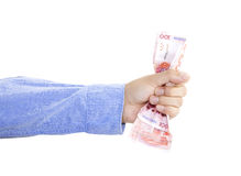 Hand squeezing bunch of money. Hand squeezing bunch of banknotes against white background Stock Photos