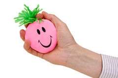 Hand squeezing funny stress ball Royalty Free Stock Image