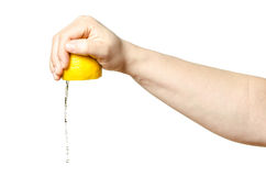 Hand squeezing lemon Royalty Free Stock Images