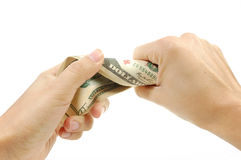 Hand squeezing money. Hand squeezing a wad of dollar banknotes Royalty Free Stock Images