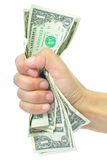 Hand squeezing money Royalty Free Stock Images