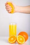 Hand squeezing orange Royalty Free Stock Photo