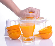 Hand squeezing orange for juice Royalty Free Stock Image