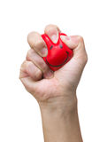 Hand squeezing smile face stress ball Royalty Free Stock Photography