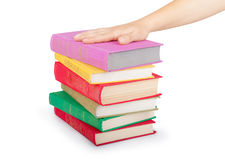 Hand on a stack of books. Isolated on white Royalty Free Stock Images