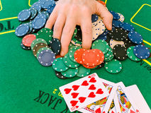 Hand on stack of chips Royalty Free Stock Image