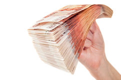 Hand with stack of russian roubles bills royalty free stock photo
