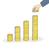 Hand stacking coins Stock Image