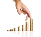 Hand and stacks of coins Royalty Free Stock Images