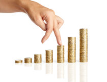 Hand and stacks of coins Royalty Free Stock Photo