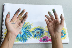 Hand with stained pastel Stock Photo