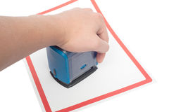 Hand with stamp for documents and paper Stock Photos