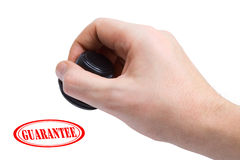 Hand and stamp Guarantee stock image