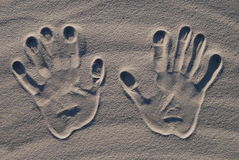 Hand stamp on the sand Royalty Free Stock Photo