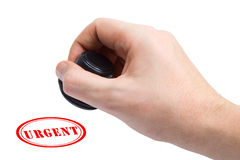 Hand and stamp Urgent. Isolated on white background royalty free stock photography