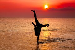 Hand stand on the beach Royalty Free Stock Image