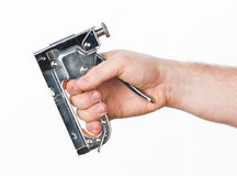 Hand with staple gun. Hand with chrome staple gun Royalty Free Stock Photo