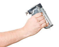 Hand with staple gun. Hand with chrome staple gun Royalty Free Stock Photos