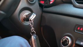 Hand starting a car engine with ignition key. Male hand starting a car engine with ignition key stock footage
