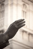 Hand on Statue Raised in Greeting Royalty Free Stock Photos