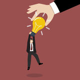 Hand stealing idea light bulb from businessman Stock Photo