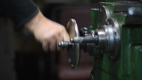 Hand steering adjustable wheel on lathe machine stock video footage