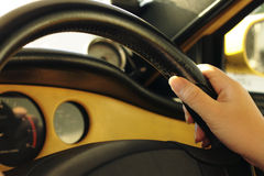 Hand and steering wheel Stock Photo