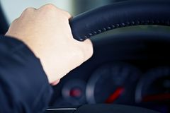 Hand on Steering Wheel Stock Photo