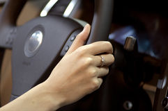 Hand and Steering wheel Royalty Free Stock Photos