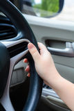 Hand on the steering wheel during on driving.  royalty free stock photo