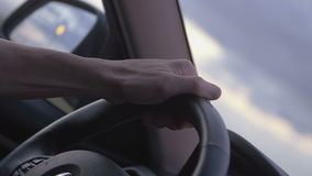 Hand on steering wheel. Man driving a car stock video