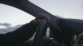 Hand on steering wheel. Man driving a car stock video footage