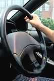 Hand on steering wheel Royalty Free Stock Image