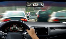 Hand on steering wheel during traffic jam. With blur motion Stock Photography