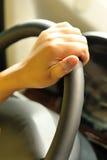 hand on steeringwheel Stock Photos